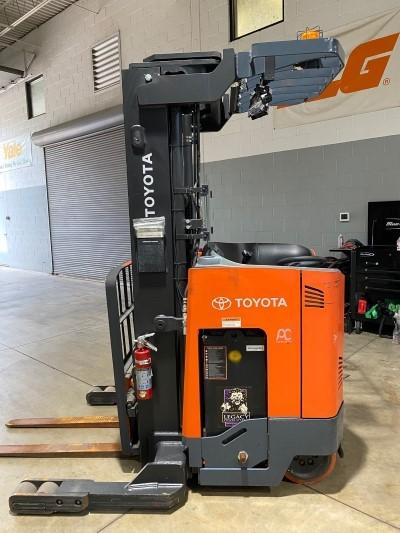 Toyota 9BRU18 electric stand up rider 3500lb narrow aisle reach truck.