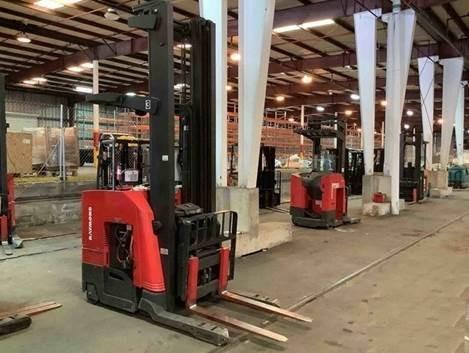 Raymond 750DR32TT electric narrow aisle 3200lb stand up rider double reach warehouse forklift.
