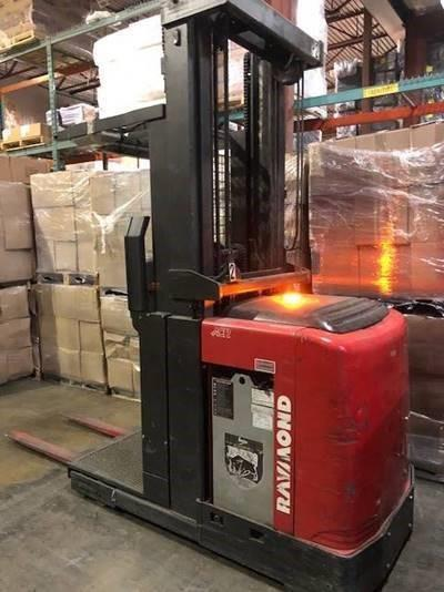 Raymond 550OPC30TT electric narrow aisle 3000lb man up stand up rider order picker forklifts.