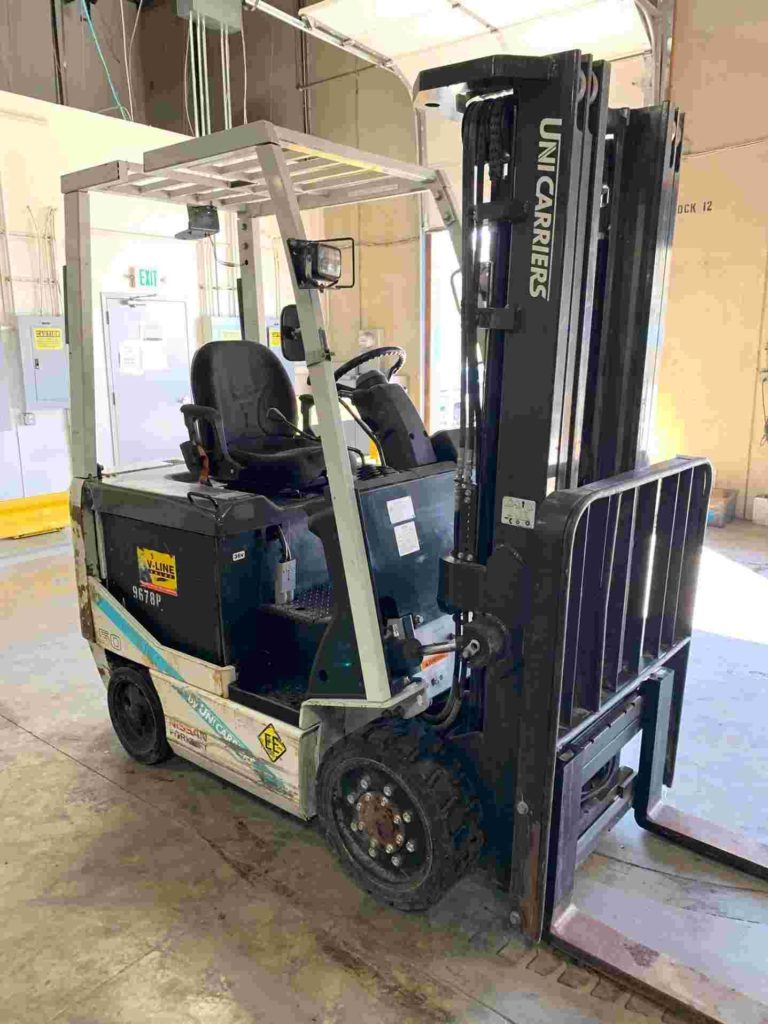 Nissan Unicarriers BXC50 electric 4 wheel sit down rider 5000lb EE rated warehouse forklifts