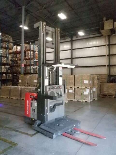 Raymond 560OPC30TT electric narrow aisle 3000lb wire guided stand up rider order picker warehouse forklift